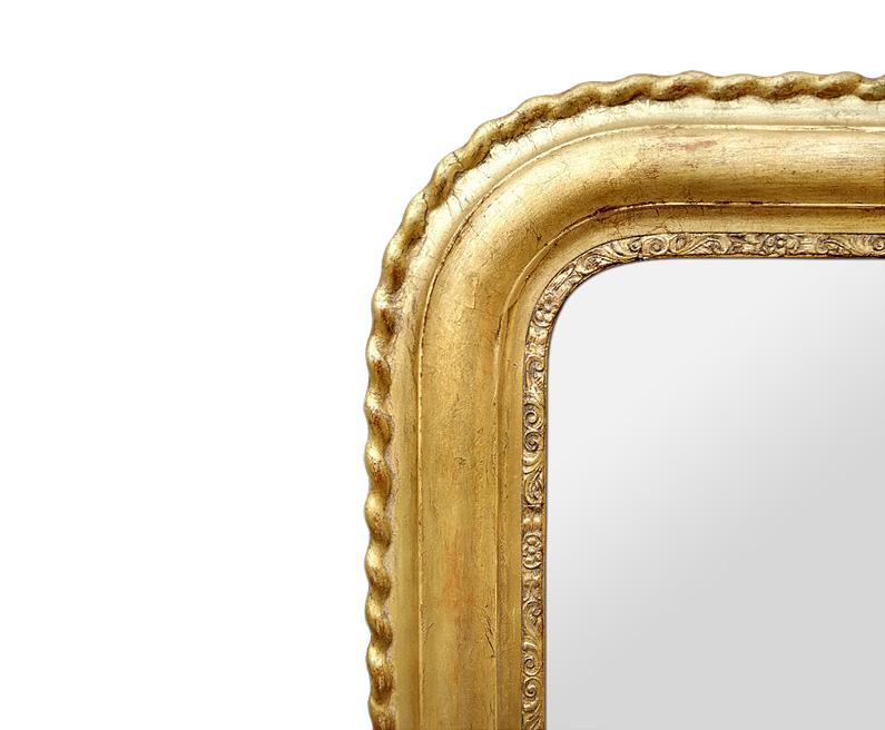 Détail cadre miroir ancien style Louis Philippe doré patiné décor torsades, fleurettes, rinceaux