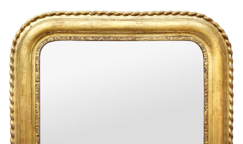 Miroir bois doré patiné décor torsades style Louis Philippe