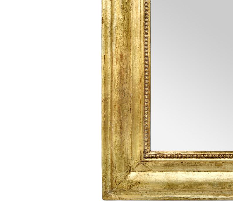 Miroir doré patine ancien style Louis Philippe décor perles