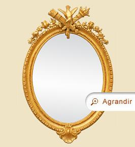 Grand miroir ovale doré décor colombe époque 19ème