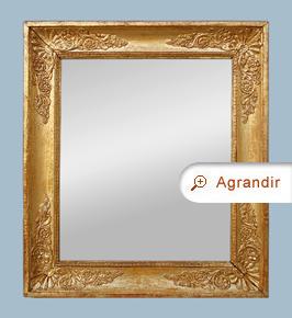Miroir ancien époque restauration bois doré à décors