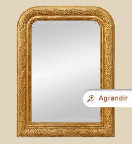 Miroir ancien Louis Philippe doré à décor de feuilles