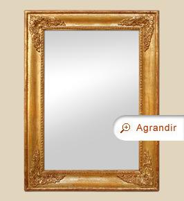 Miroir doré ancien XIXème à décors de style Restauration