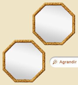 Paire de miroirs anciens octogonaux dorés